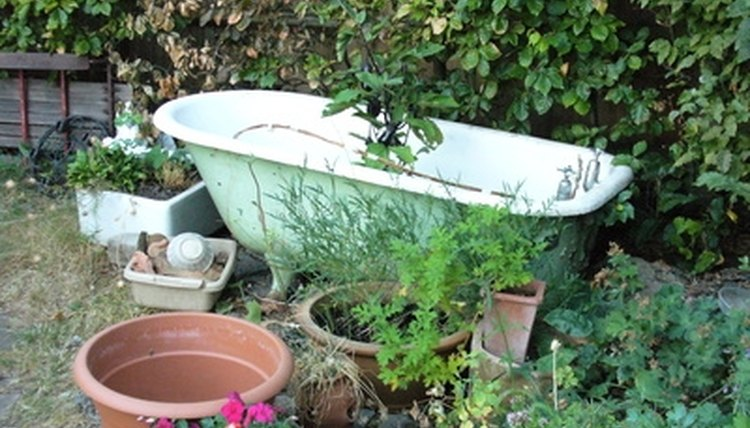 Antique claw foot tubs, substantial cracks, garden accessories