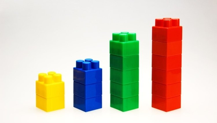 Manipulatives such as stacking blocks can introduce children to mathematical concepts.