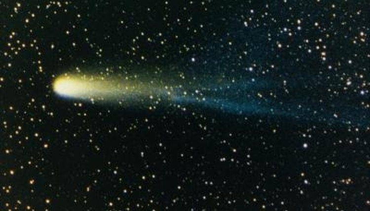 Comets approaching the sun develop luminous tails that extend for long distances.