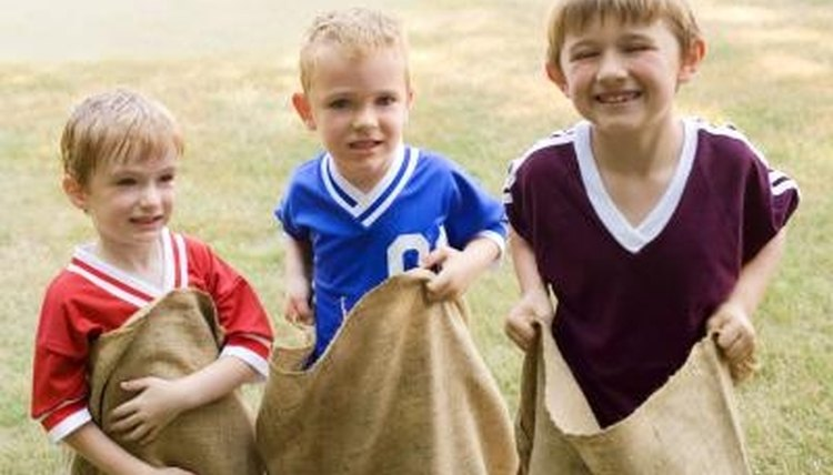 a sack race, elementary children, field day
