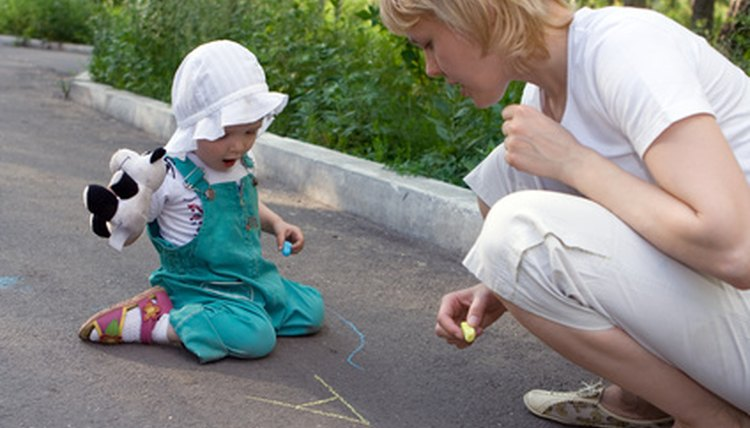 Drawing with chalk outside is a perfect activity for a spring day.