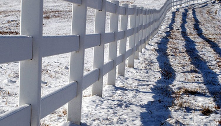 A fence marks the perimeter of a plot of land.