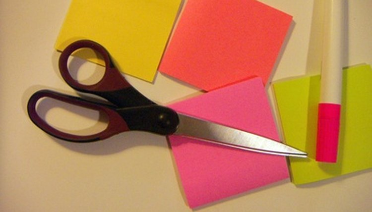 Low-tech equipment such as colored sticky notes can help students with visual impairments stay organized.