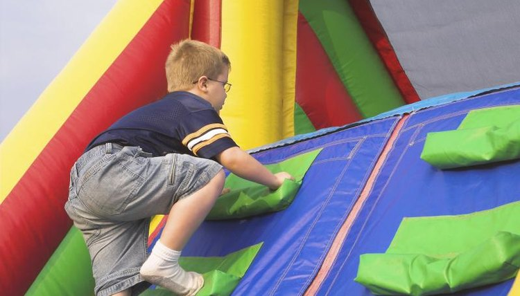 A boy is completing an obstacle course.