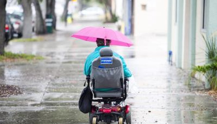 Wheelchair-bound woman riding home in Miami, FL.