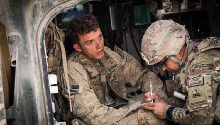 Military medic tends to a soldier.