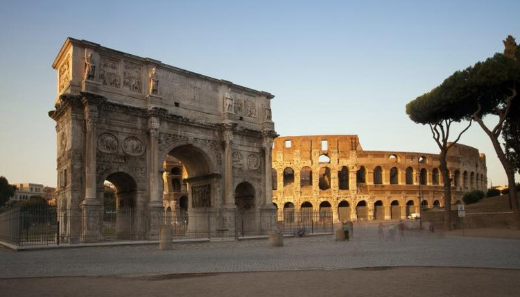 The Arch of Constantine and the Colosseum in ancient Rome.