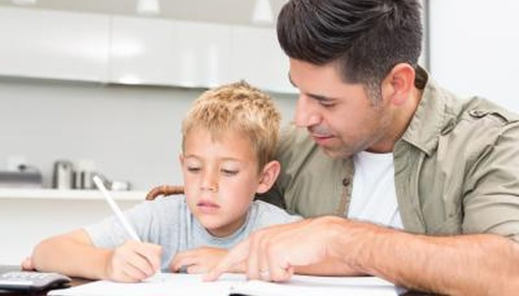 Father helping son with math homework
