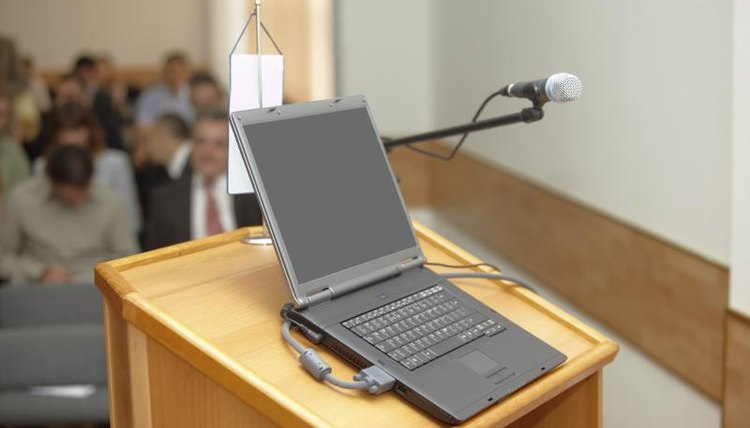 Debate podium with microphone and laptop