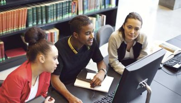 Students accessing the database in a library.