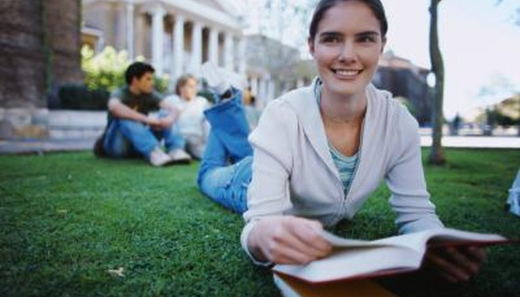 College student studying on lawn