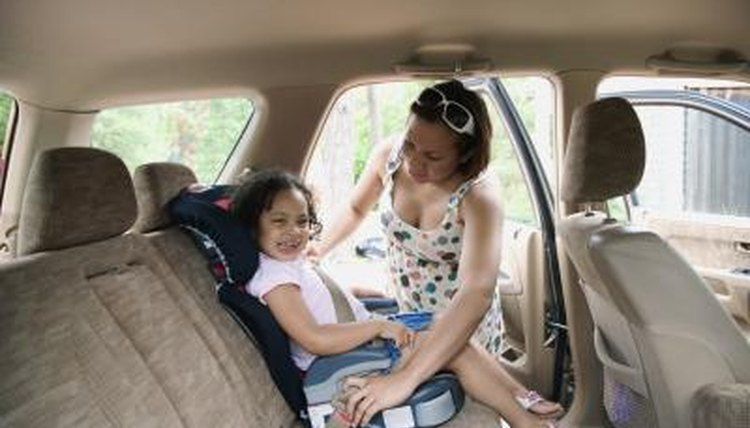 Mother putting chip in carseat