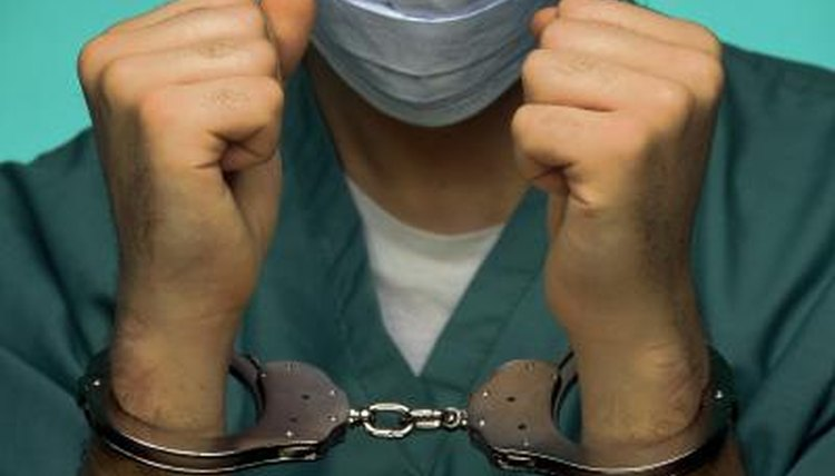 Doctor in handcuffs