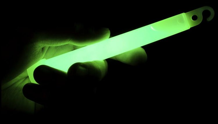 A hand holding glow stick
