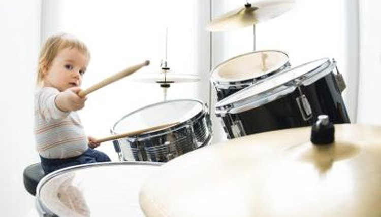 A child playing a drum.