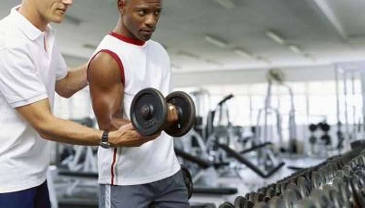 Muscular man exercising at the gym
