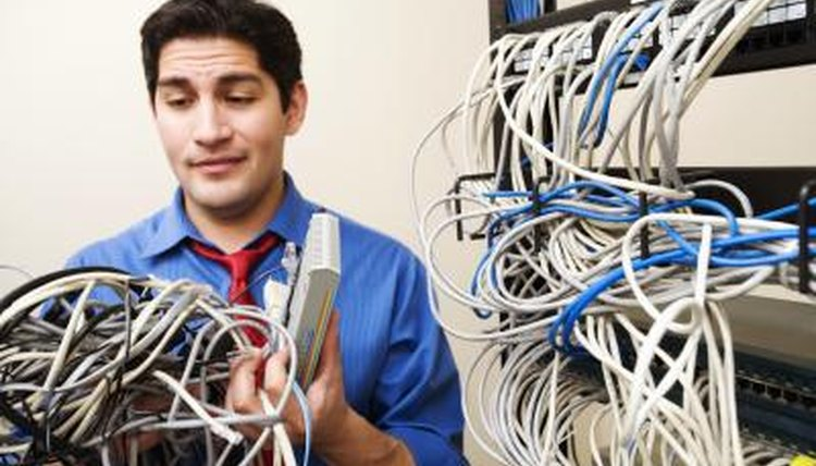 Student working tech in server room.