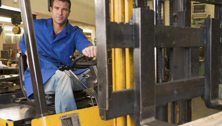 A warehouse worker, a forklift