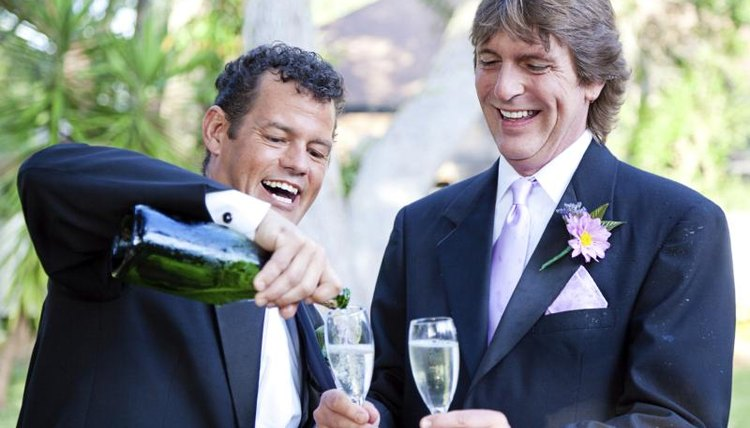 A gay couple is pouring champagne to celebrate their marriage.