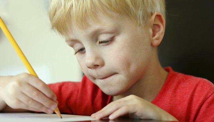 First grader using pencil to write