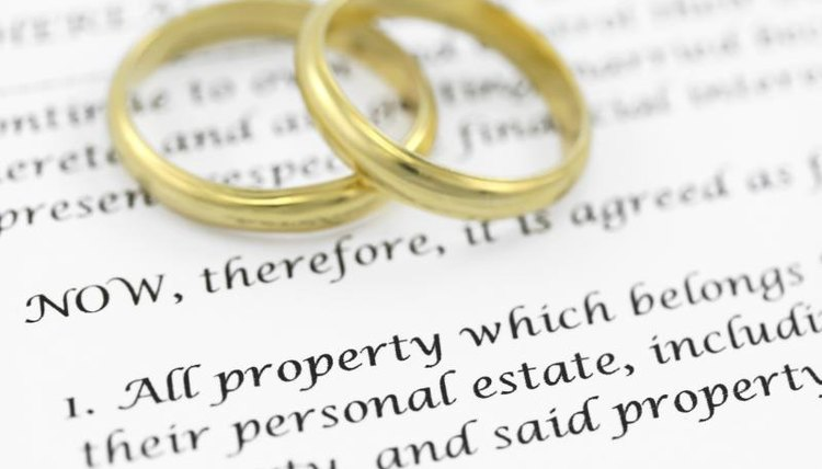 A close-up of wedding rings on divorce papers.
