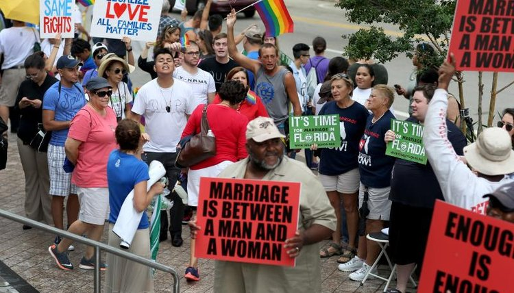 Advocates for gay marriage rallying near opponents.