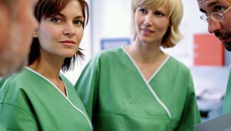 Two female nurses in scrubs.