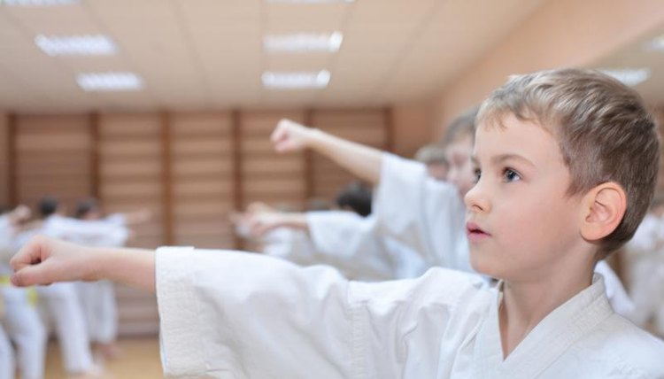 Boy punching at martial arts class.