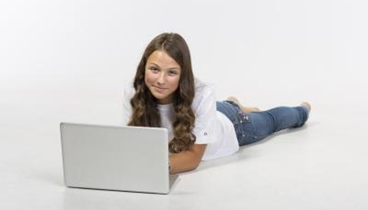 Young girl taking an online test.