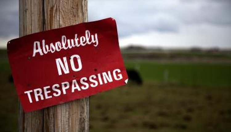 No Trespassing sign on farm