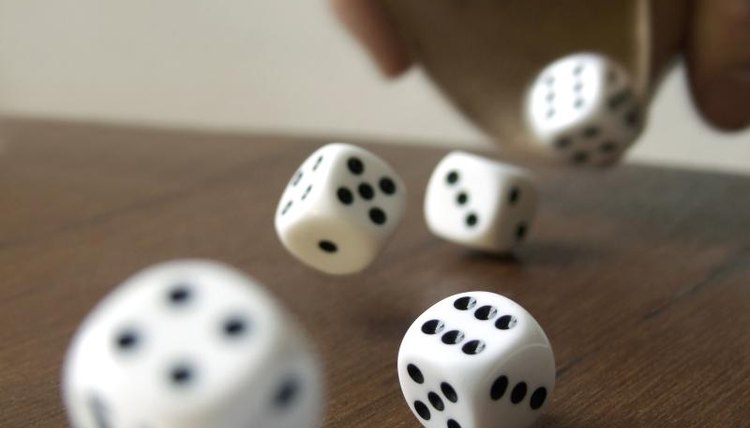 Dice, a table, frame