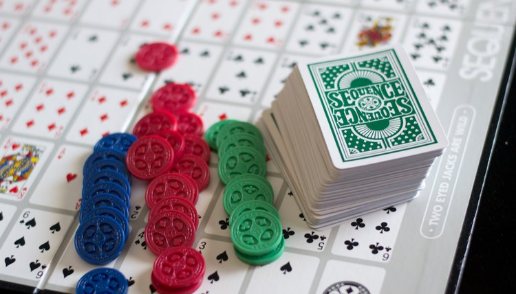 """Sequence&quot, blue, green and red chips, 104 playing cards"