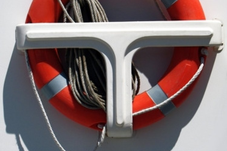 Tie a figure-eight knot to secure a line to a ring buoy.