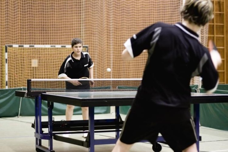 Two competitors playing a game of table tennis.