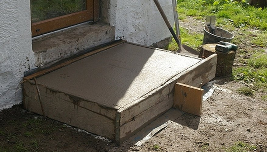 A leveled concrete step for a study door.