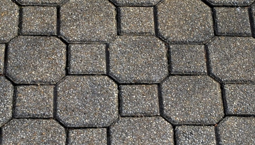 Create a patio with paver stones to improve your landscape.