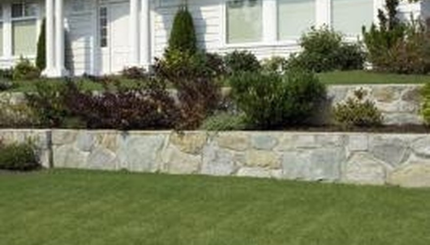 You can make a retaining wall out of wood or stone.