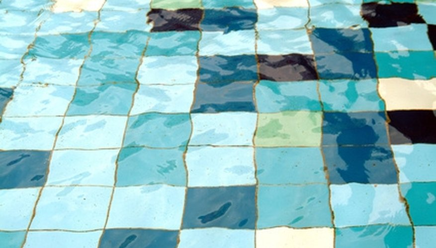 Black algae can make a pool appear to have dirty, black spots on the surface.