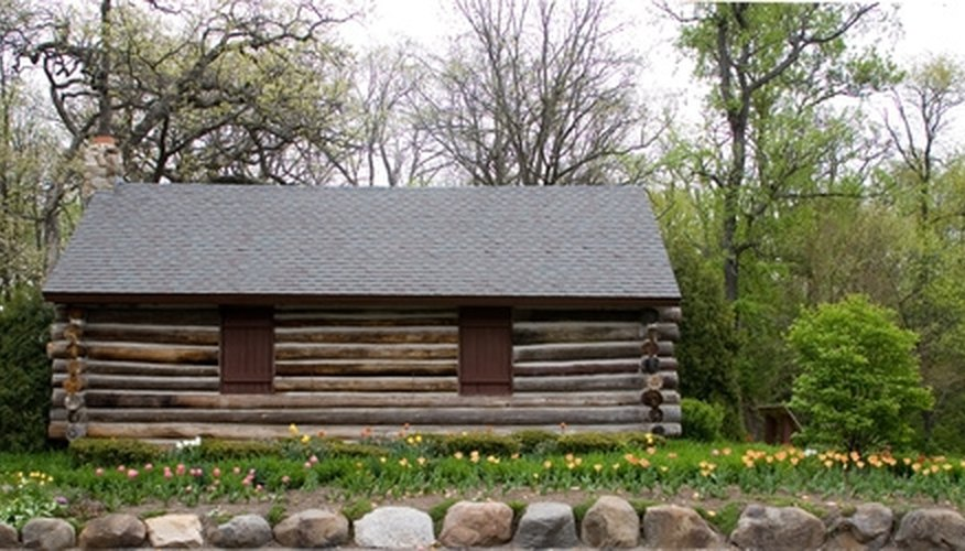 A simple and cost-efficient foundation for a log cabin is a concrete slab.