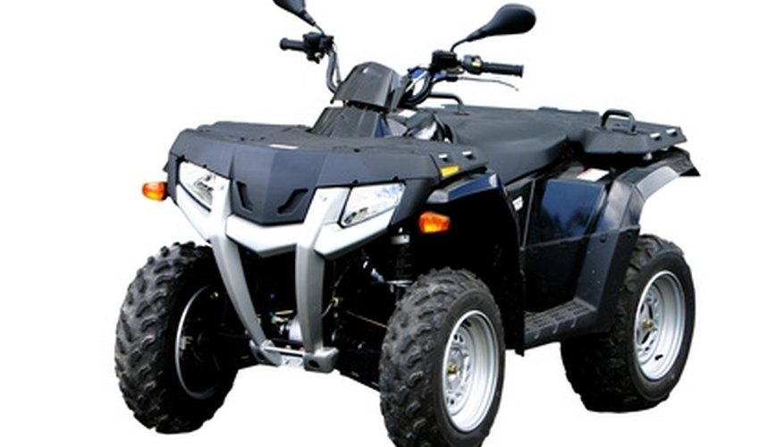 An ATV can be used to plow a garden.