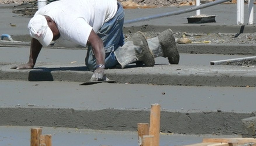 Anchor bolts are often cast into wet concrete slabs for attaching walls and fixtures later.