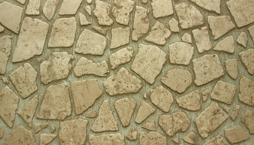 Natural flagstones are used to create a strong and stable driveway surface.