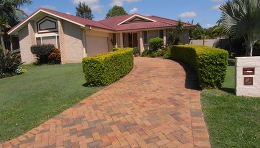 Clean your driveway pavers once a year to preserve their appearance.