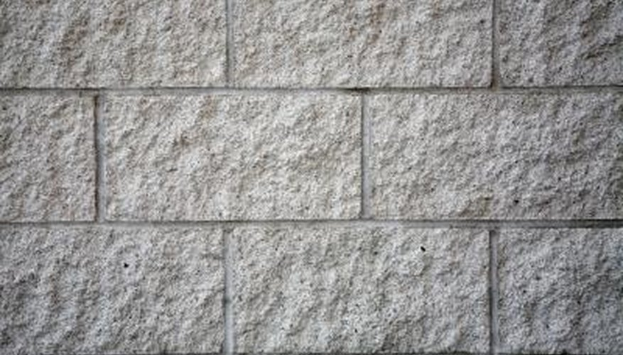 Wedge anchors attach building materials to solid concrete walls.