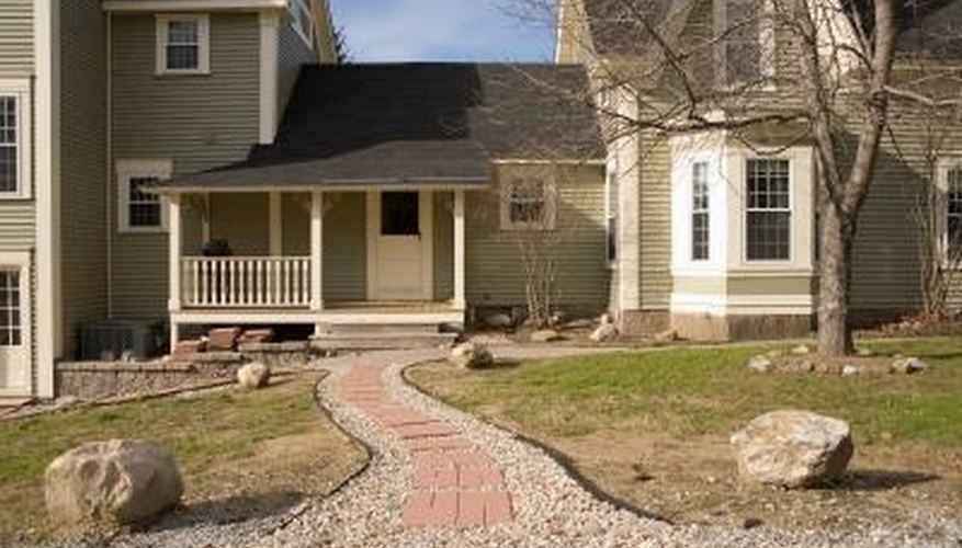 A front gravel walkway can add beauty to a home.