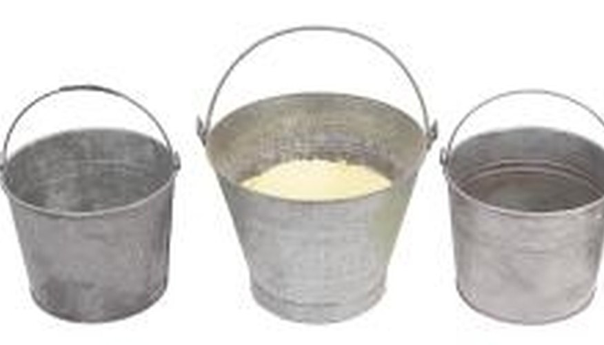 Recycle old galvanized pails to make pots for vegetable plants.