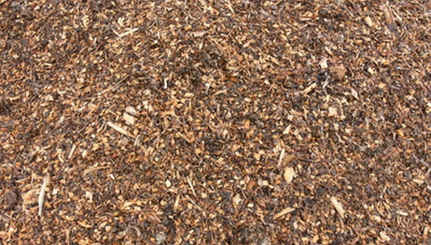 Mulch is applied to soil to stimulate growth.