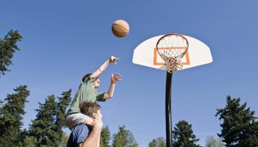 An outdoor basketball goal needs a firm foundation in concrete.