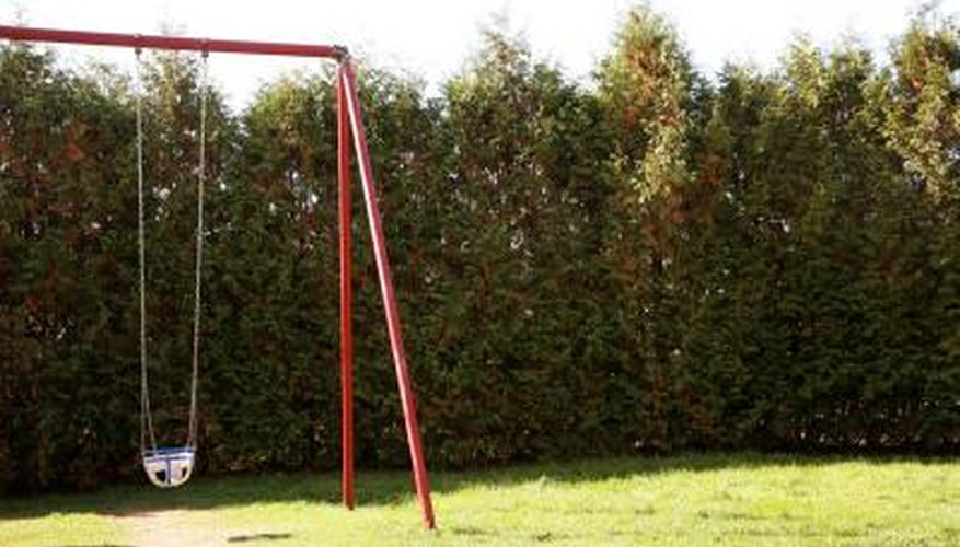 Set the legs of a swing set in concrete for stability.