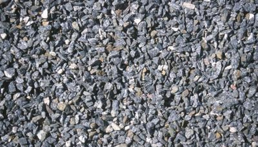 Create a new gravel driveway that keeps rocks from spreading.